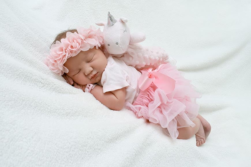 Soft toys are a must have addition to baby photography.