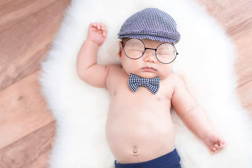 In newborn photography, use accessories to create interesting photos.