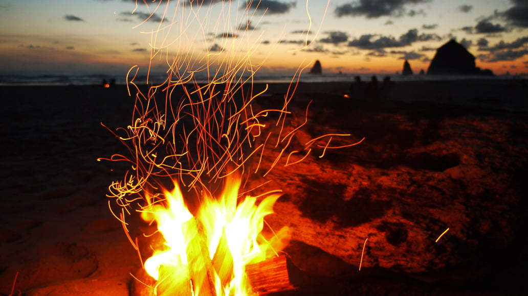 A campfire on the sand is a great example of an effective beach photo.