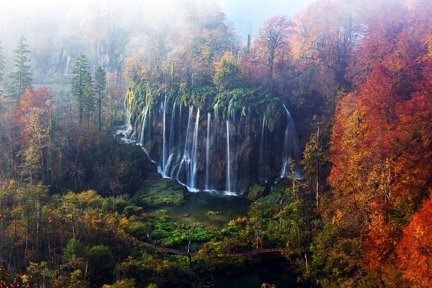 Waterfall in autumnal scene.