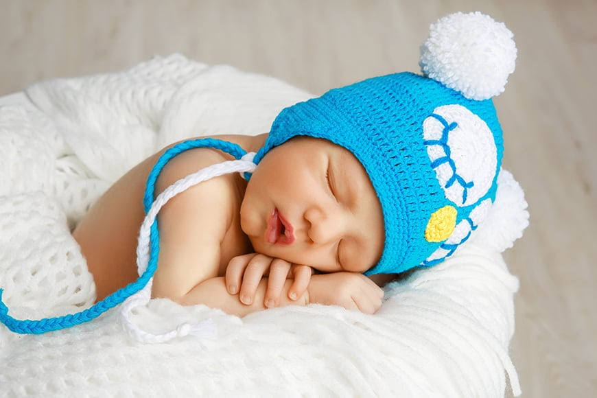Comfortable newborn photography props are key. Try a blanket or bean bag.