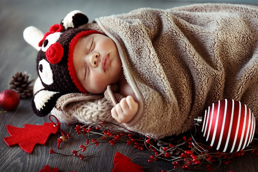 Newborn photos props can be seasonal for example christmas themed.