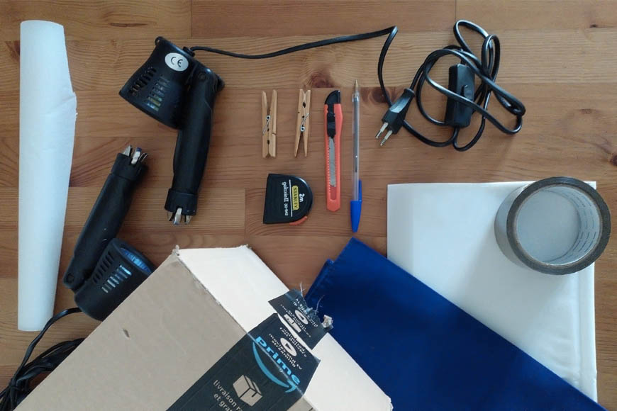 Materials for a DIY light box can be found at a regular hardware store – poster board, white paper, box cutter, desk lamp, light bulbs, etc.