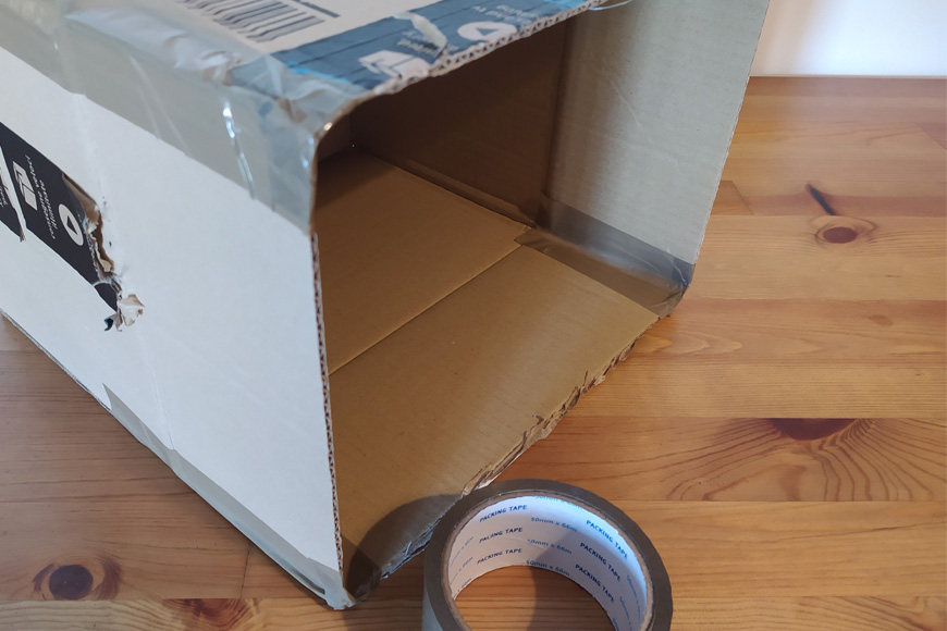 Step 1 of DIY light box - tape flaps.