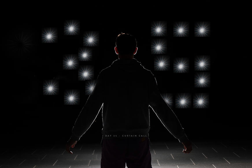 Photography - one man standing in front of painting light
