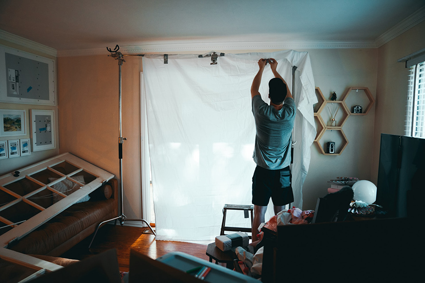 Use DIY materials like fishing line, craft paper, white paper, foam board, scrap wood, folding table, tape, etc as budget products for photography.