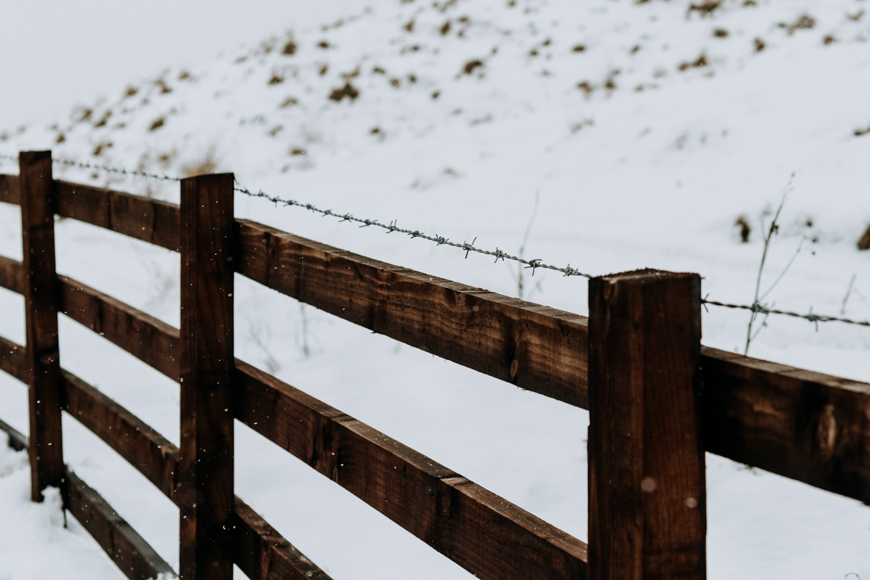closeup of a wooden fence in a wintery setting