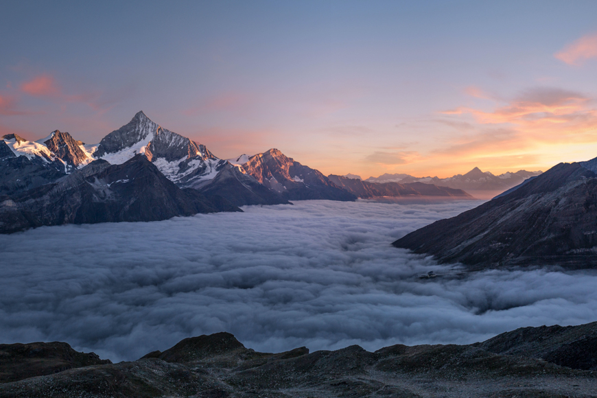 Cloud covered mountains at sunrise