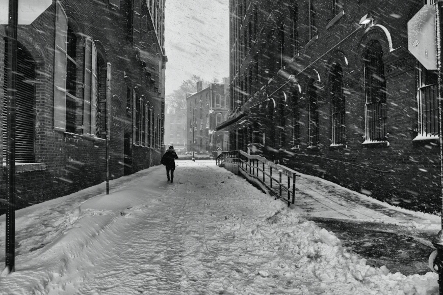 Man walking outside on a snowy day
