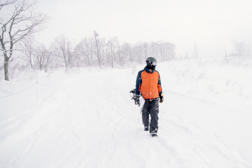 Snow photography tips include wearing appropriate clothing in snowy conditions