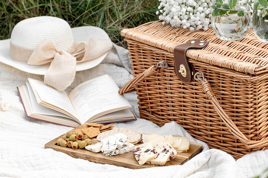 still life picnic basket with flowers can be used for spring photos