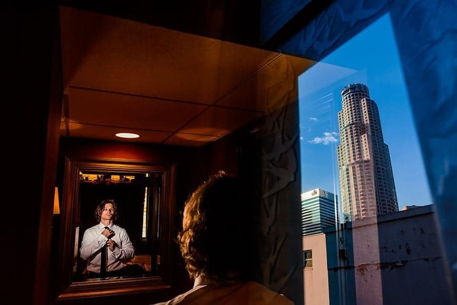 Double exposure shot of a man and U.S. Bank Tower building