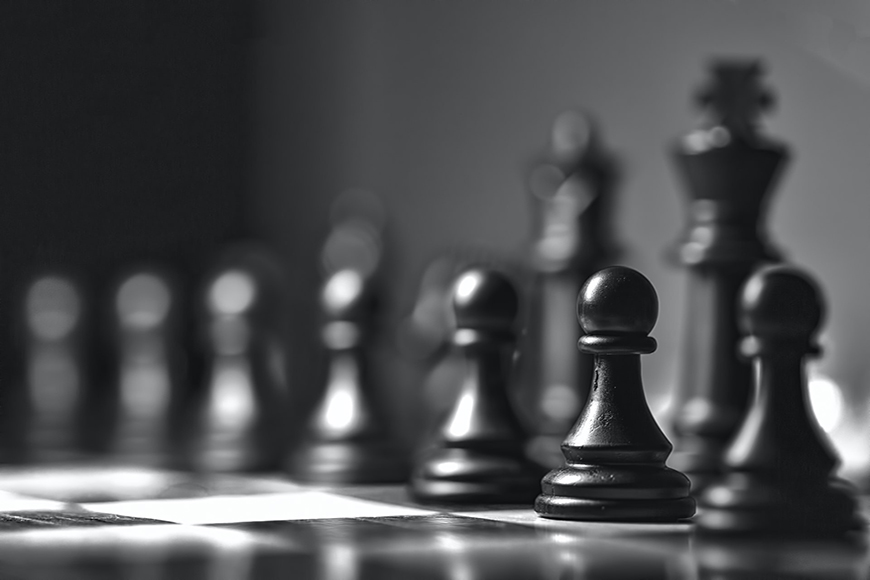 Photography basics - aperture controls what is in focus on the chess pieces.