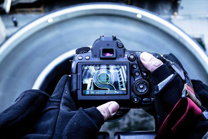 Photography for beginners - man holding a camera showing the LCD screen