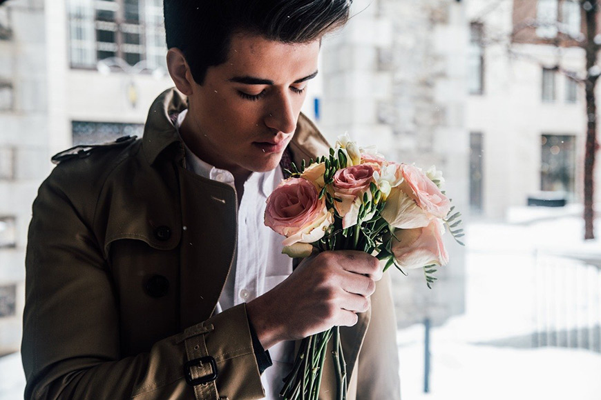 Modelling poses - male holding flowers for a prop