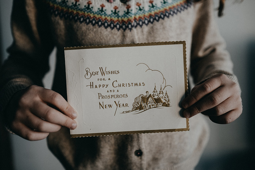 Close up of a Christmas card being held by a child