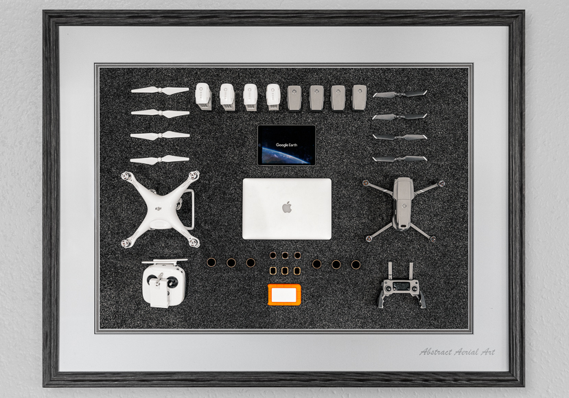 Flatlay of drone photo equipment with different drone models including DJI Phantom 4 Pro.