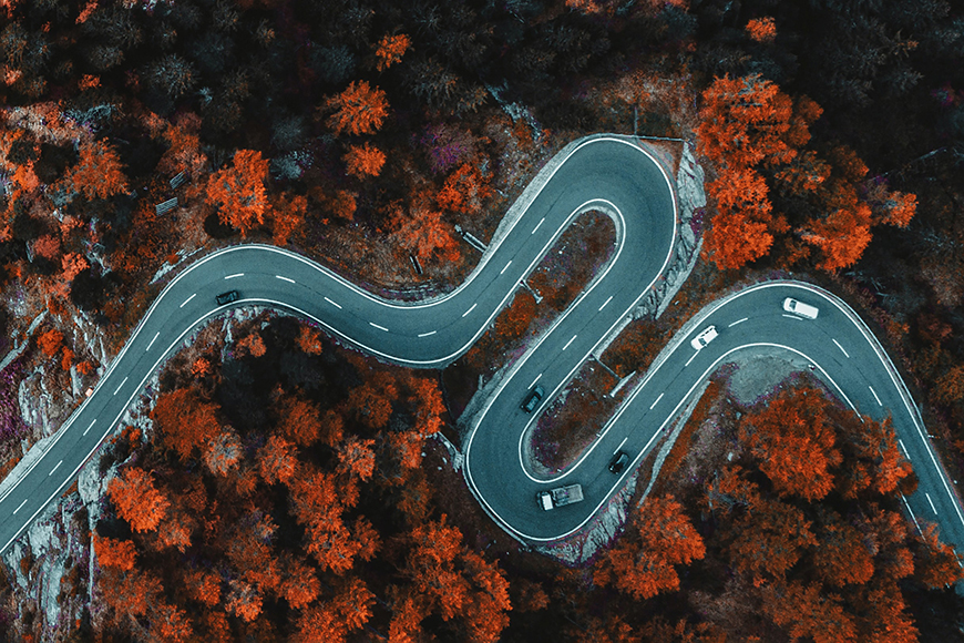 Drone photo of a winding road taken with camera from above.