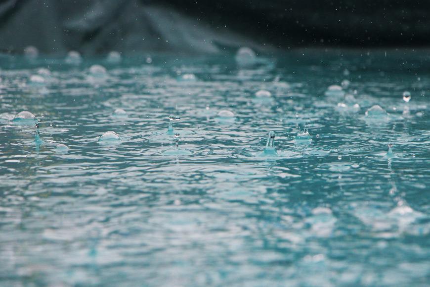 Rain hitting water