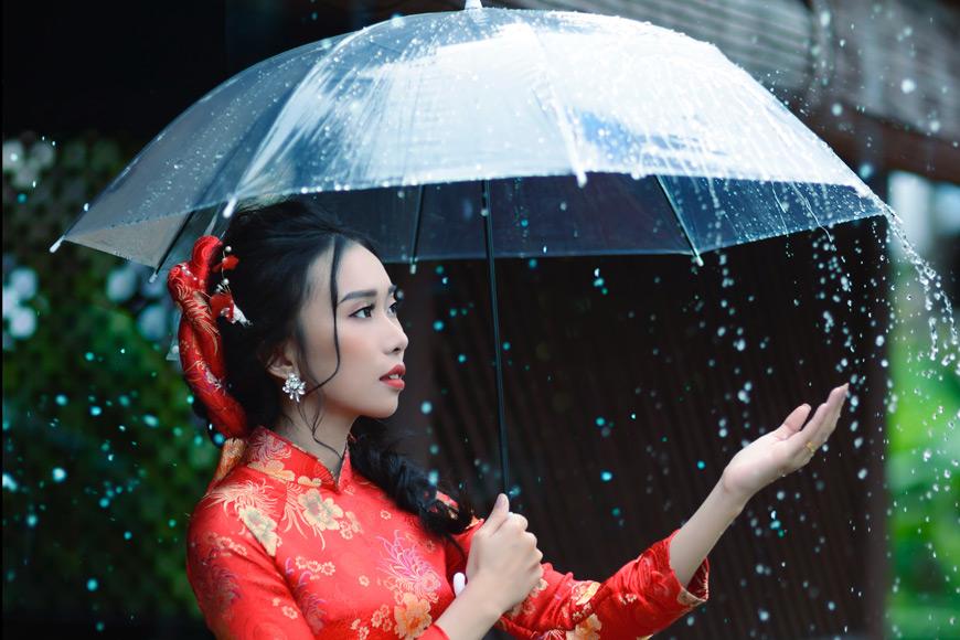 Women in red standing under an umbrella