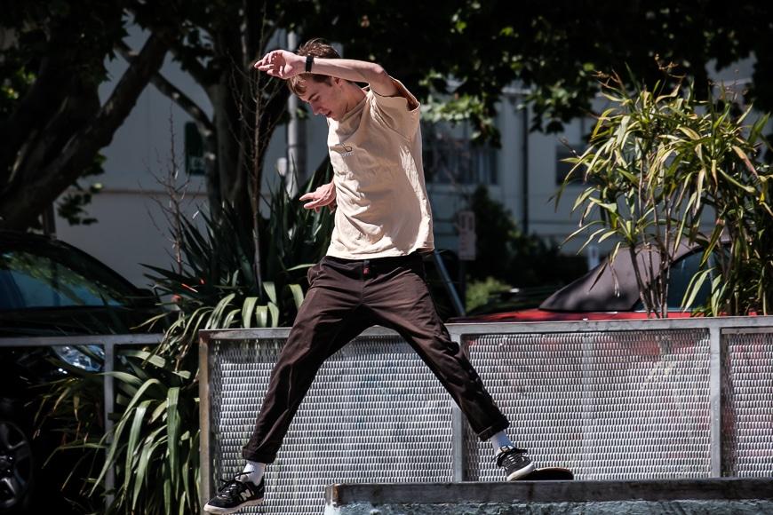 Man in long pants skating