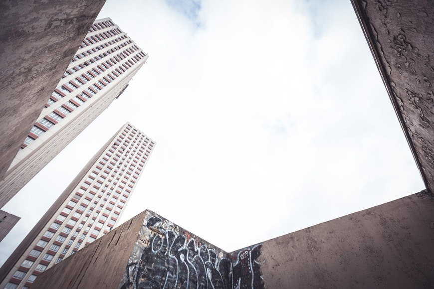 Looking up at buildings and the sky from the ground