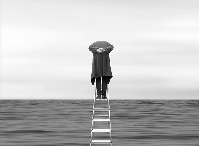 man on ladder in black and white