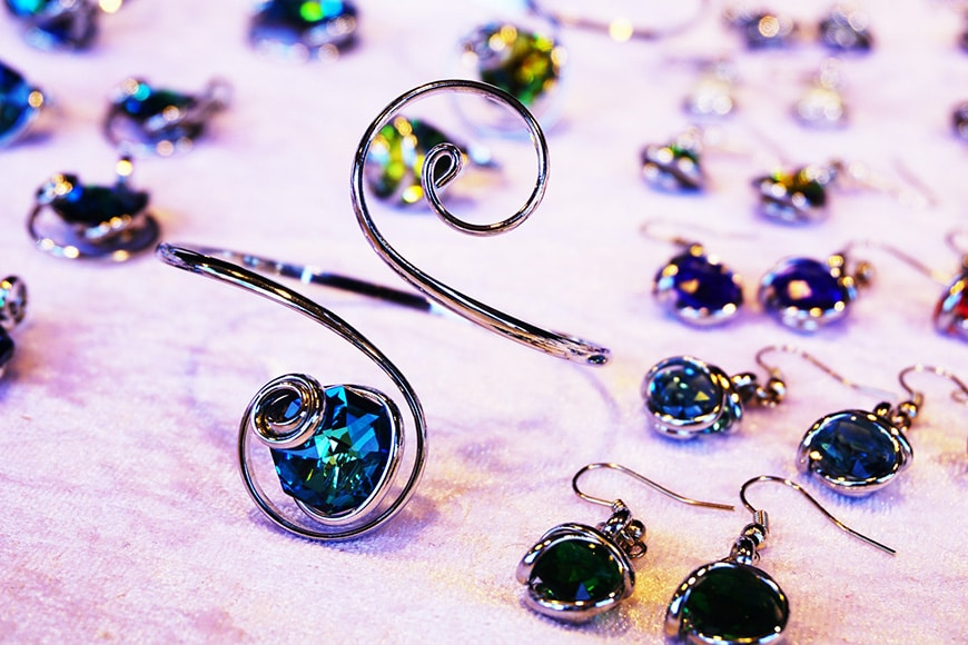 jewellery photography - earrings and bracelet against purple background