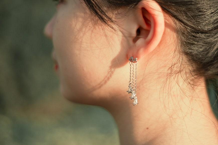 jewellery photography - a women wearing long earrings