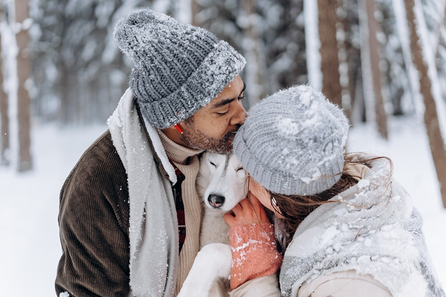 Couple and dog in snow