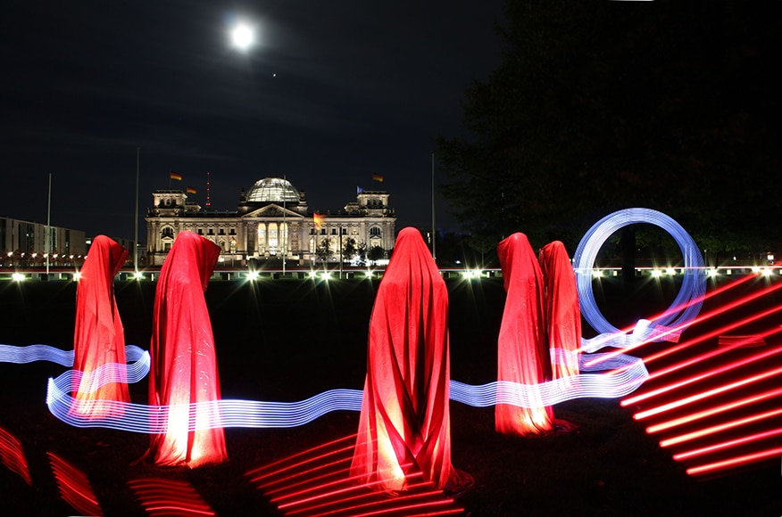 figures in red with light painting