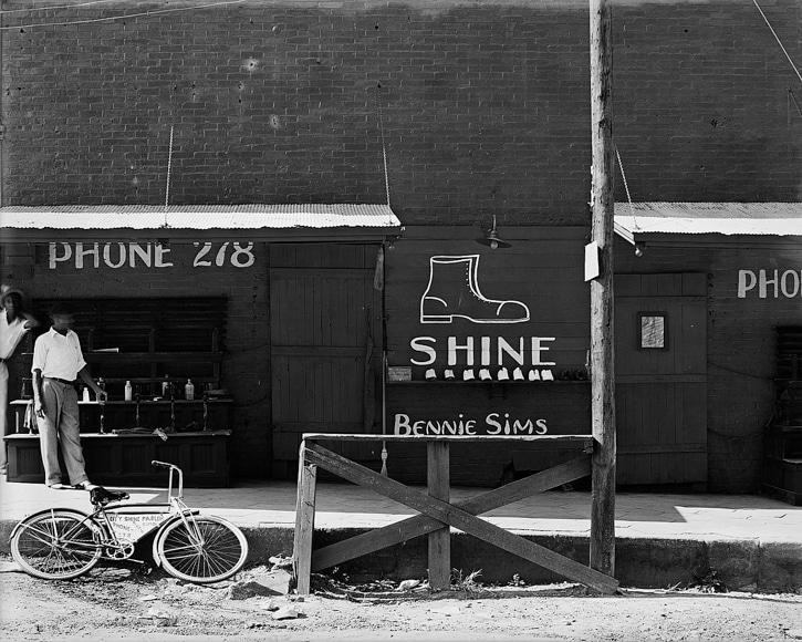 black white photo of urban street side