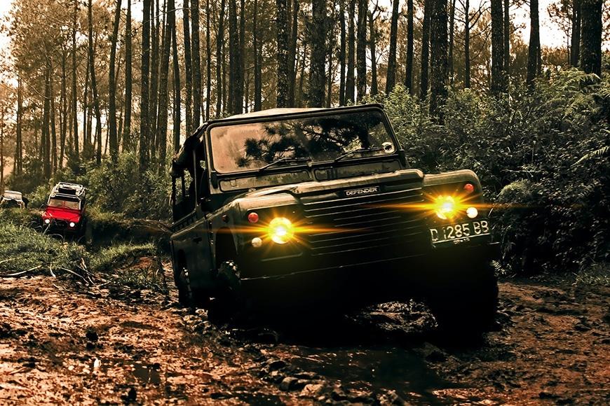 Off-road vehicles driving through rough terrain