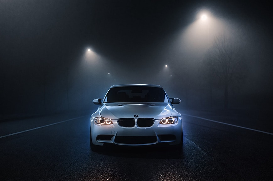 Car on the road at night with mood lighting