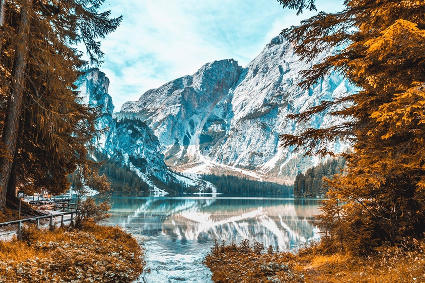 Beautiful snow-capped mountains against golden foliage