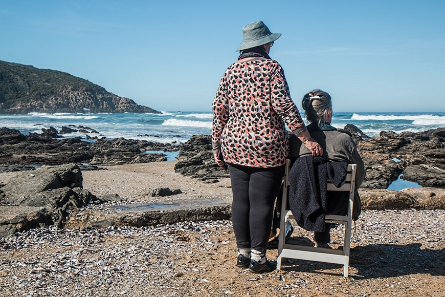 Two elderly women looking out to sea