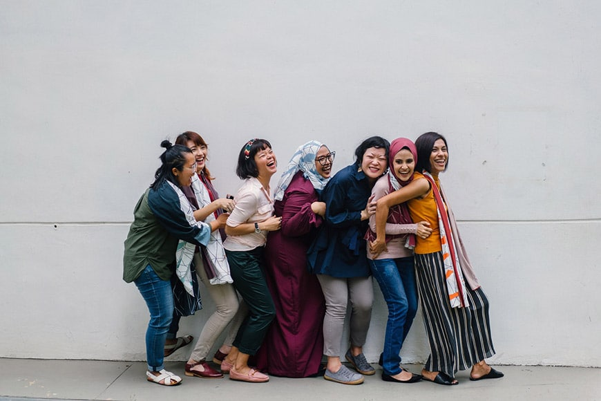 Female friend group posing and laughing