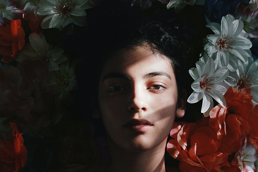 Woman lying down with face half in shadow