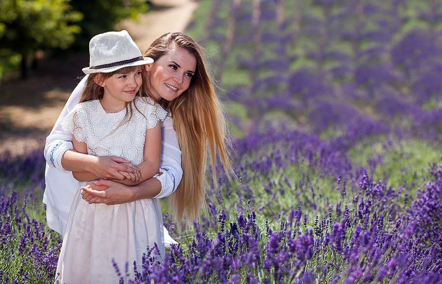 A women holding her daughter in a lavender field