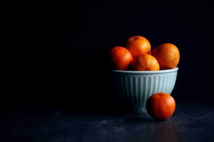 Still life photo of a bowl of mandarins