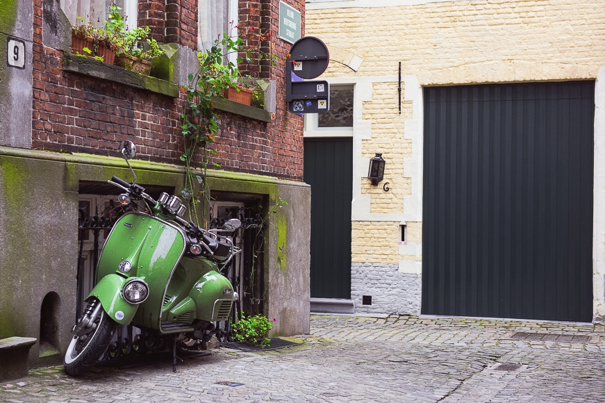 Cobbled street with a green scooter