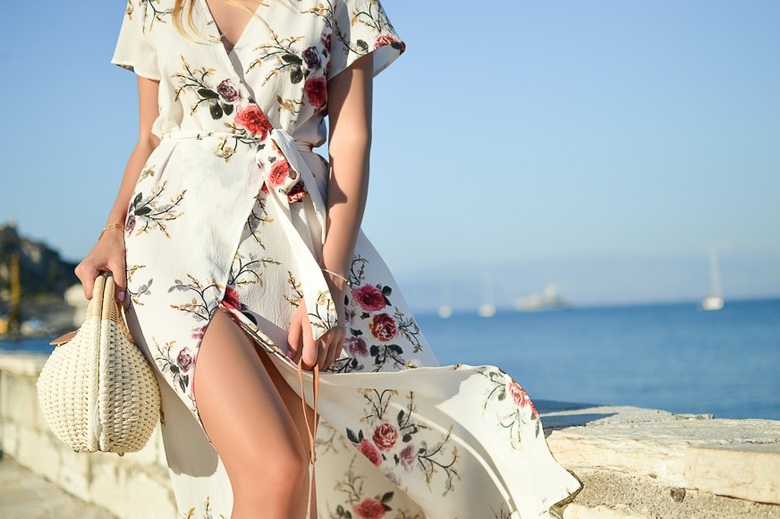 Lower body shot of a women wearing a floral dress