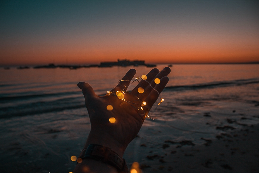 Bokeh effect on a persons hand with a water background