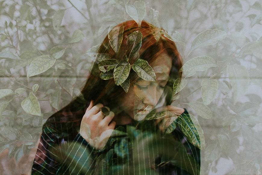 Double exposure image of a women and green garden scene