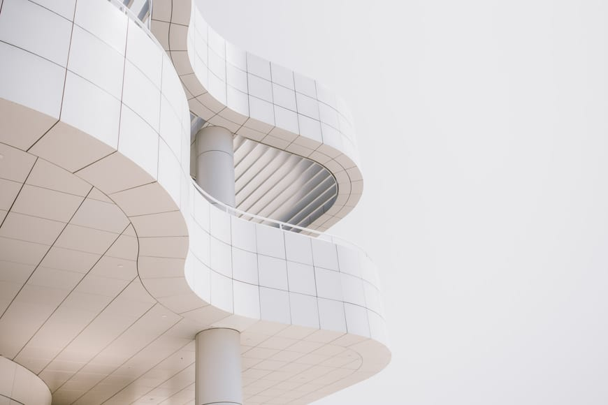 Dramatic angle of a white structure with curved edges