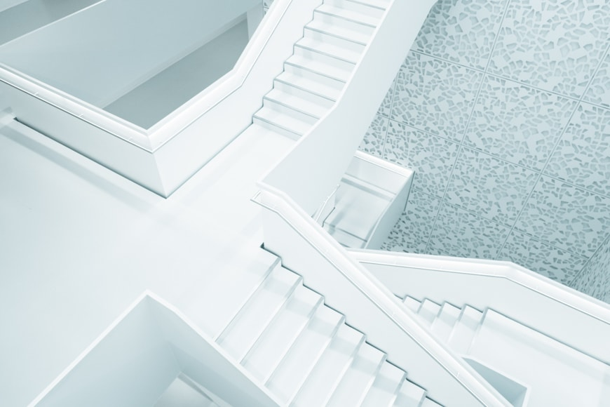 Interior photo of white stair cases
