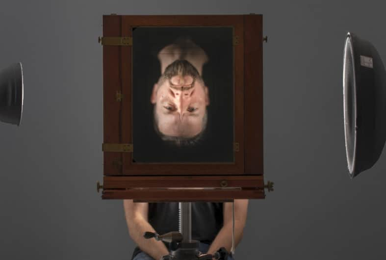 Taking an exposure for wet plate photography