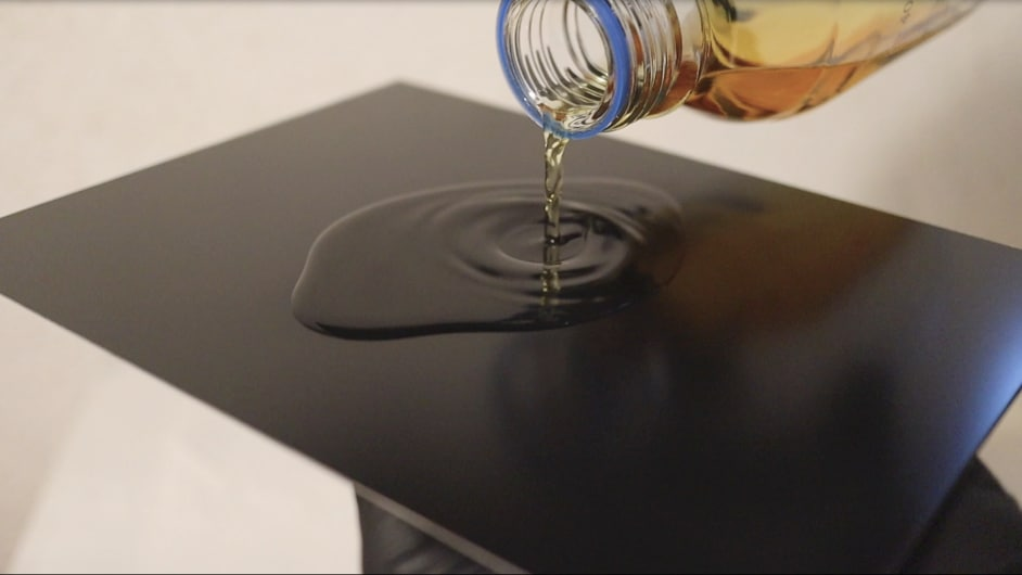 Pouring the collodion onto the plate