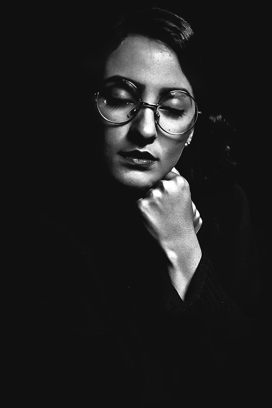 Black and white portrait of a woman with glasses