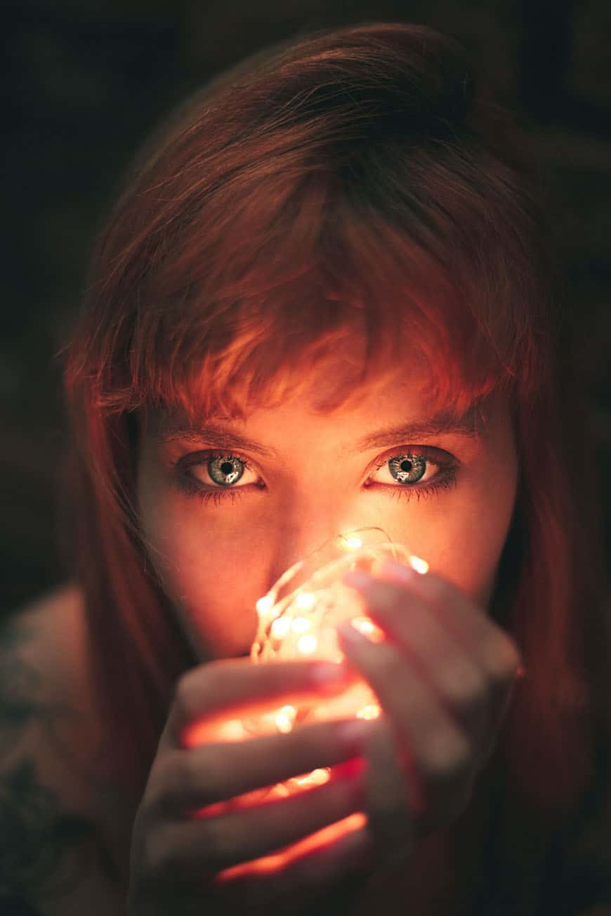Photo shoot of a girl holding fairy lights